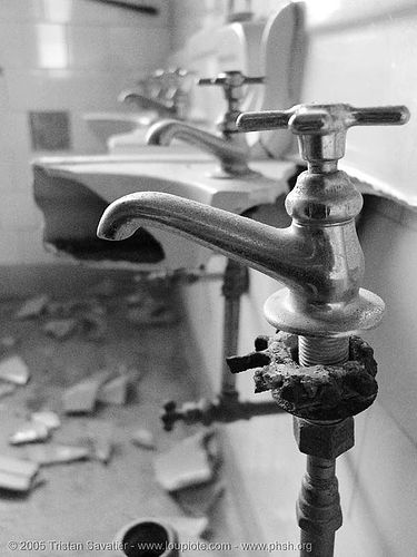faucets in vandalized restroom, abandoned building, abandoned hospital, bathroom, faucets, presidio hospital, presidio landmark apartments, sinks, toilet, trespassing, vandalism, vandalized