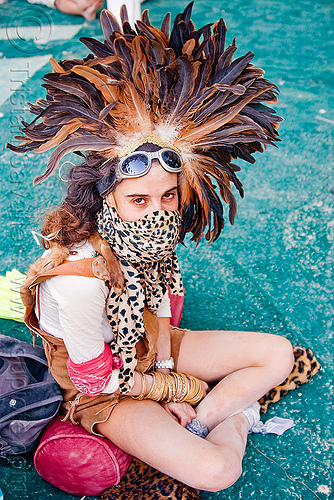 feather hat, bracelets, burning man, center camp, costume, feather headdress, feather headwear, feathers, goggles, leopard, panther, woman