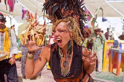 feather mohawk - burning man 2012, center camp, dreads, feather mohawk, feathers, headdress, natalie, necklaces, woman