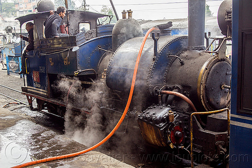 filling-up steam locomotive with water - darjeeling train station (india), 788 tusker, darjeeling himalayan railway, darjeeling toy train, filling-up, hose, india, men, narrow gauge, operators, railroad, smoke, smoking, steam engine, steam locomotive, steam train engine, train station, workers