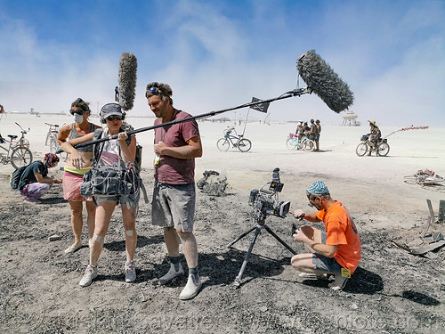 film crew on the man's ashes - burning man 2019, ashes, burn, burning man, film camera, film crew, mic, microphone, sound boom, the man