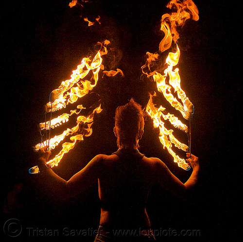 fire angel - leah with fire fans (san francisco) - fire dancer, angel wings, backlight, fire dancing, fire performer, fire spinning, flames, night, people, spinning fire, tattooed, tattoos, woman