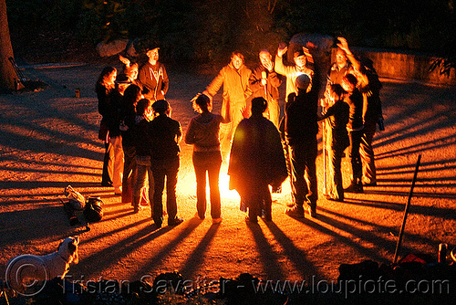 fire circle - rays of light, bonfire, ceremonial, ceremony, fire circle, fire dancers, fire performers, fire spinning, gathering, night, rays, shadows, solar flare