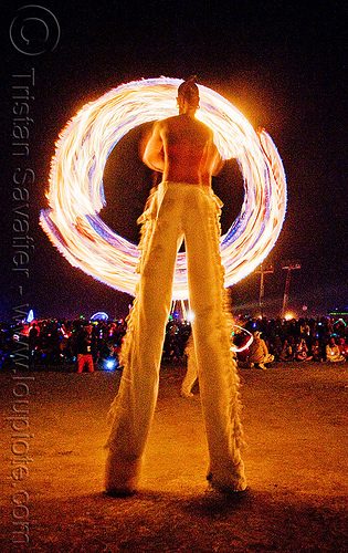fire conclave - spinning fire ropes on stilts - burning man 2009, burning man, circle, fire conclave, fire dancer, fire dancing, fire performer, fire ropes, fire spinning, flames, night of the burn, ring, spinning fire, stilts, stiltwalker, stiltwalking