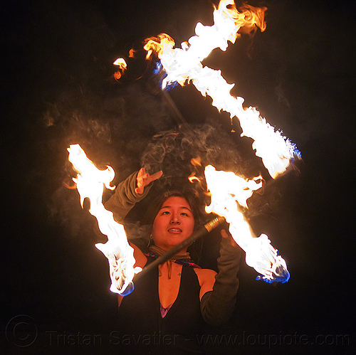 "fire dancer ""mel"" with double fire staffs, fire dancing, fire performer, fire staff, flames, night, staves double, woman"