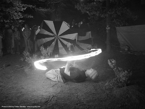 fire-dancer - rainbow gathering - hippie, fire dancer, fire dancing, fire performer, fire spinning, fire staff, flames, long exposure, night, people, rainbow family, spinning fire