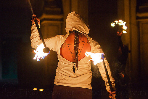 fire dancer with back tattoo, double staff, fire dancing, fire performer, fire spinning, fire staffs, flames, mel, night, people, staves, tattooed, tattoos, triangle tattoo, triangles tattoo, woman