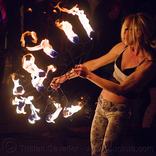 fire dancer with fire fans, american steel studios, cressie mae, fire dancer, fire dancing, fire fans, fire performer, fire spinning, flames, holidays in flux, night, oakland, poplar gallery, spinning fire, woman