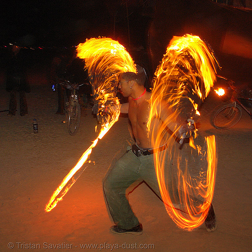 fire dancer with fire swords - burning-man 2006, art, burning man, celsius maximus, fire dancer, fire dancing, fire performer, fire spinning, fire swords, flames, long exposure, night, spinning fire