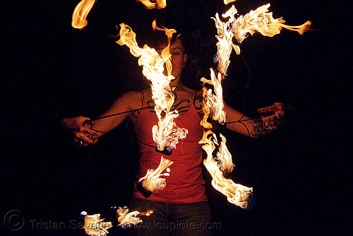 fire fans (san francisco) - fire dancer - leah, fire dancer, fire dancing, fire fans, fire performer, fire spinning, flames, leah, night, spinning fire, tattooed, tattoos, woman