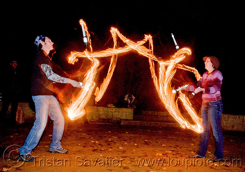 fire jugglers passing clubs, fire clubs, fire jugglers, fire performers, flames, juggling clubs, long exposure, night, solenne alexa, two, vincent deluca