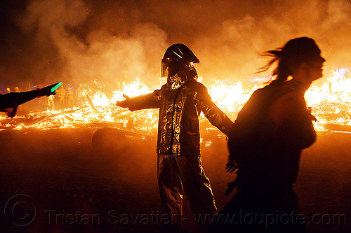 fire line - burning man 2012, backlight, burning, fire proximity suit, firefighter, flames, helmet, night, silhouettes, the man