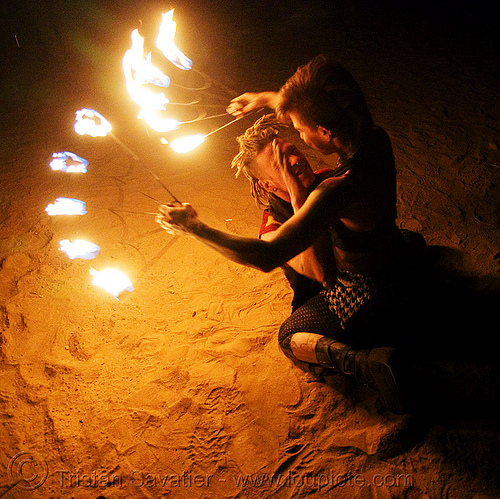 the fire of love - leah and ro with fire fans (san francisco) - fire dancer, desert, desert party, fire dancing, fire performer, fire spinning, flames, man, night, people, psy trance, rave party, spinning fire, tattooed, tattoos, woman
