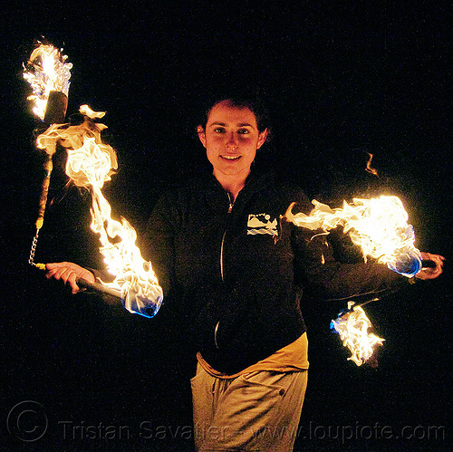 fire performer - fire nunchaku, fire dancer, fire dancing, fire nunchaku, fire performer, fire spinning, night, nose piercing, sarah, septum piercing, woman