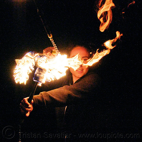 fire performer spinning fire nunchaku, fire dancer, fire dancing, fire nunchaku, fire performer, fire spinning, night, nose piercing, sarah, septum piercing, woman