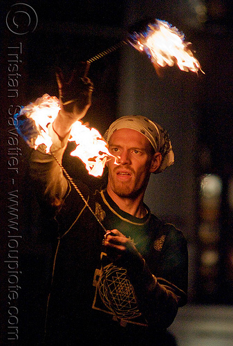 fire performer - temple of poi 2009 fire dancing expo - union square (san francisco), fire dancer, fire dancing expo, fire performer, fire poi, fire spinning, flames, man, night, spinning fire, temple of poi