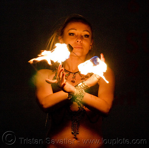 fire performer - temple of poi 2009 fire dancing expo - union square (san francisco), fire dancer, fire dancing expo, fire performer, fire spinning, flames, forka, manda lights, night, spinning fire, surya, sûrya, temple of poi, woman