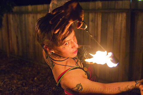 fire performer with fire doohickey, fire dancer, fire dancing, fire doohickey, fire performer, fire spinning, leah, night, woman