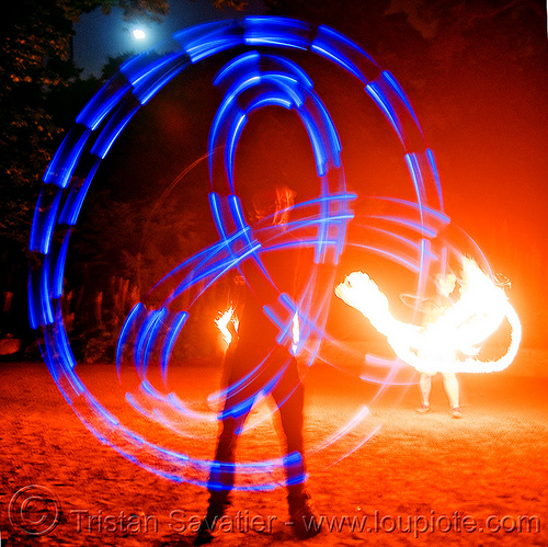 fire performers - spinning light poi - flowlights (san francisco), fire dancer, fire dancing, fire performer, fire spinning, glowing, led lights, led poi, led staff, light poi, light staffs, nicky evers, night, spinning fire