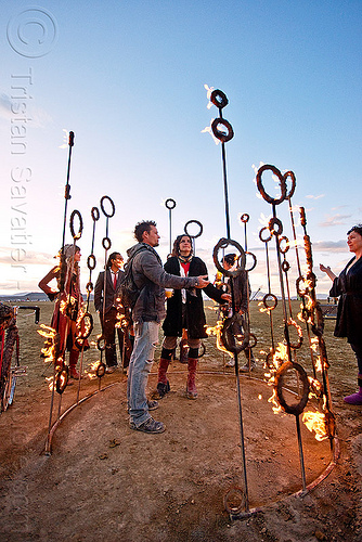 fire sculpture - nucleus by kasia danuta-bilhartz, burning man, dusk, fire, flames, people, rings, sculpture