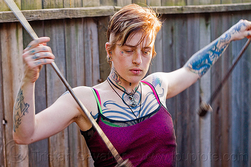 fire staffs practice, fire staffs, fire staves, leah, tattooed, tattoos, woman