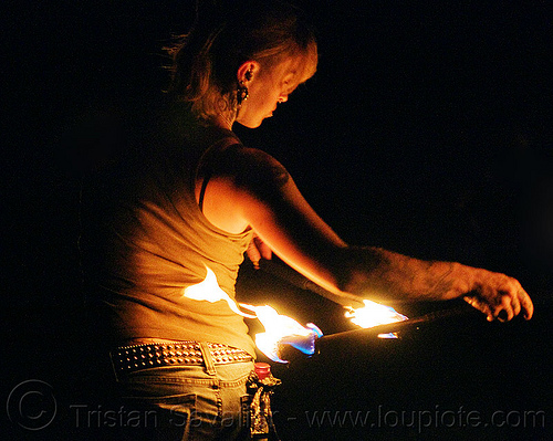 fire staves - hips - leah, fire dancer, fire dancing, fire performer, fire spinning, fire staffs, fire staves, flame, leah, night, tattooed, tattoos, woman