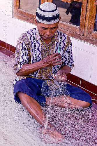 repairing fishnet, fisherman, fishing net, fishnet, fixing, hat, java, man, repairing, sitting, tamansari, working
