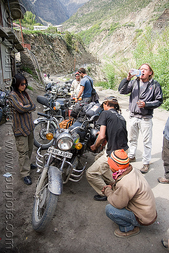 fixing the bikes - motorcycle mechanic shop - keylong - manali to leh road (india), christoph, grace, mechanic, motorbike touring, motorcycle touring, road, royal enfield bullet, woman