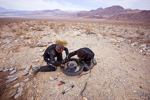 fixing a motorcycle flat tire in the desert, adv rider, adventure rider, death valley, dual-sport, fixing, flat tire, ktm, motorbike touring, motorcycle touring, noobs rally, puncture, repairing, saline valley, wheel