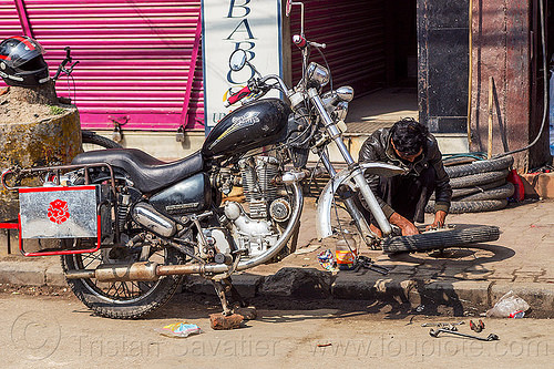 fixing puncture - royal enfield bullet motorbike - kathmandu (nepal), fixing, flat tire, man, mechanic, motorbike touring, motorcycle touring, puncture, repairing, royal enfield bullet, street, thunderbird, wheel