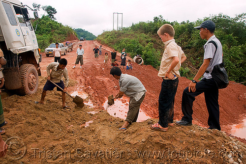fixing the road with shovels (laos), lorry, men, mud, people, ruts, shoveling, tracks, truck