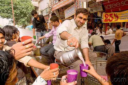 free pink drinks - hindu holiday - delhi (india), delhi, free drinks, hands, jar, pink, pitcher, plastic cups, pouring, street, water