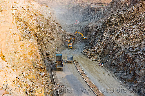 freeway construction through rocky terrain near udaipur (india), at work, excavator, freeway construction, groundwork, india, road construction, roadworks, trucks, udaipur, working