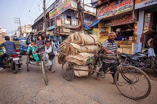 freight tricycle and cycle rickshaw (india), bags, bearer, cargo tricycle, cargo trike, cycle rickshaw, freight tricycle, freight trike, heavy, india, load, man, motorcycles, moving, passengers, sacks, shops, traffic, transport, transportation, transporting, varanasi, walking