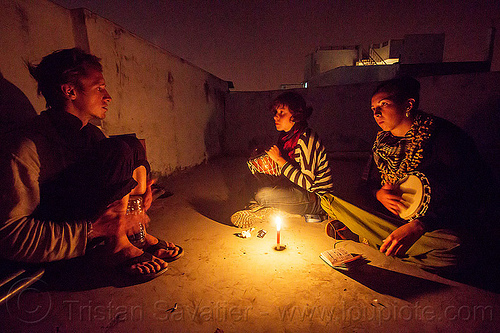 friends sitting around candle (india), candle, djembe drum, drummer, drumming, india, malou, night, pierrot, sitting, varanasi, women
