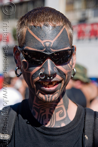 full face tattoo, dore alley fair, earrings, full face tattoo, man, nose piercing, nose ring, nostril piercing, septum piercing, sunglasses, tattooed, tattoos, tribal tattoo