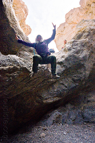 fun times in grotto canyon, dana, death valley, grotto canyon, jump, jumper, jumping down, jumpshot, mountain, peace sign, rock, slot canyon, woman