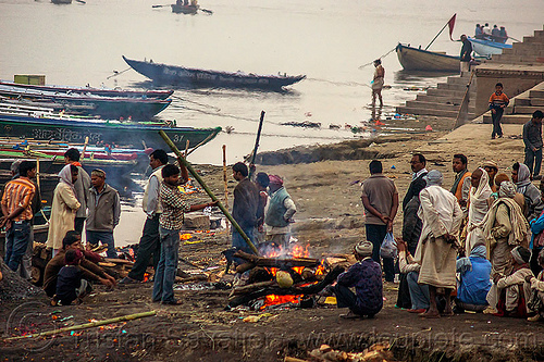 funeral pyre - cremation of a dead at harishchandra burning ghat - varanasi (india), burning ghat, corpse, cremation ghats, dead, fire, funeral pyre, ganga river, ganges river, harishchandra ghat, hindu, hinduism, human cadaver, river boats, smoke, smoking, varanasi, water