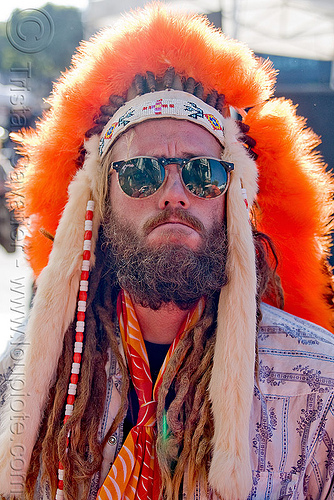 fuzzy indian head dress, bead, fuzzy, glowing, haight st, haight street fair, head dress, hippie, man, menlesohn, orange, singlasses