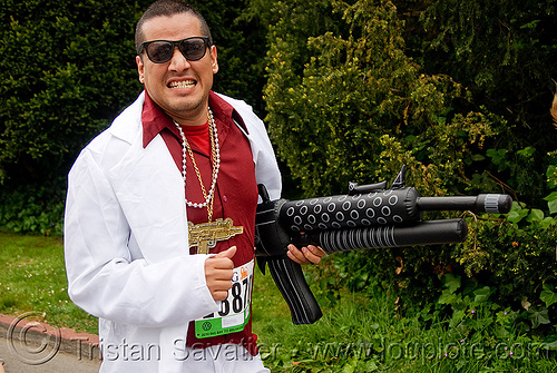 gangster with inflatable gun, automatic weapon, bay to breakers, costume, festival, footrace, gangster, hand gun, hitman, inflatable gun, machine gun, mafia, mafioso, man, runner, street party, suit, sunglasses, toy gun, white