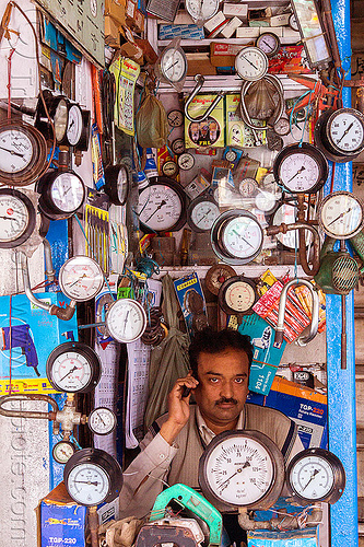 gauge shop (india), delhi, dials, man, many, merchant, pressure gauges, shop, sitting, store, vendor