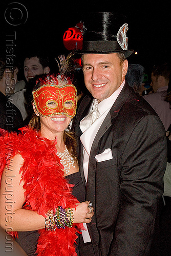 ghostship halloween party on treasure island (san francisco), costume, feather boa, feathers, ghostship 2009, halloween, man, mask, rave party, red, space cowboys, stove pipe hat, woman
