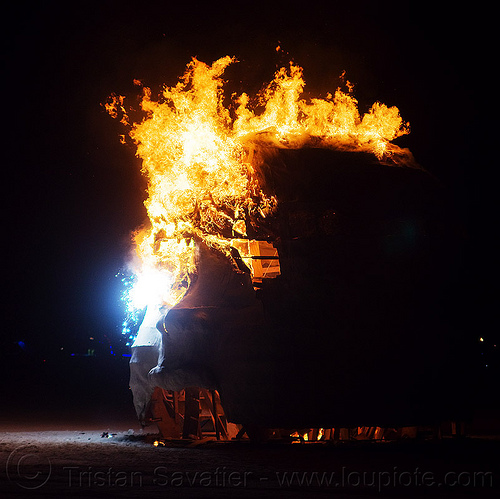 baby head on fire - burning man 2013, art installation, baby head, burning man, child head, fire, flames, night, psychokinetic child, sculpture