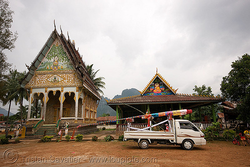 giant bamboo fireworks rocket on pickup truck - temple - vang vieng (laos), bamboo rocket, buddhism, buddhist temple, fireworks, laos, pyrotechnics, vang vieng, wat
