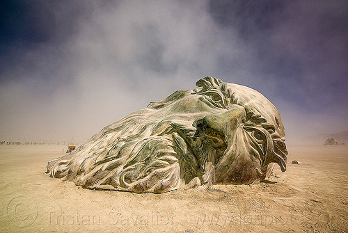 giant da vinci's head half buried in the playa - burning man 2016, art installation, burning man, da vinci head, giant head, sculpture
