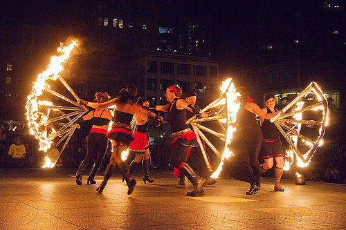 giant fire fans, fire dancer, fire dancing expo, fire fans, fire performer, fire spinning, night, solar flare, spinning fire, temple of poi