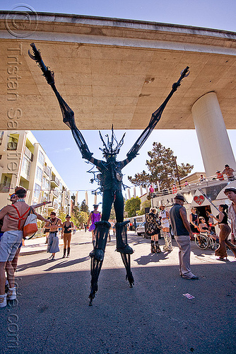 giant insect costume, arms up, black, burning man decompression, costume, insect, kevin, overpass