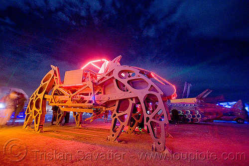 giant motorized mechanical spider - the walking beast - burning man 2009, art car, biomimicry, burning man, glowing, mechanical spider, moltensteelman, motorized spider, mutant vehicles, night, walker, walking beast, walking machine