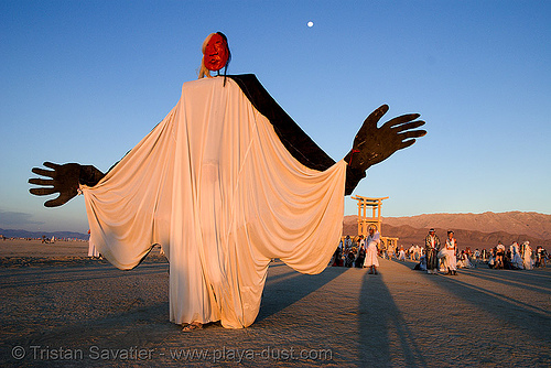 giant puppet at the silent white procession - burning man 2007, coyote rising, dawn, people, sun rise, white morning