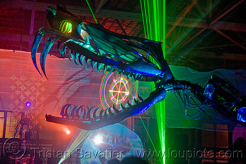 giant snake skeleton animated sculpture - opulent temple massive rave party (treasure island, san francisco) - serpent mother, art installation, fangs, green laser, head, laser lightshow, laser show, lasers, night, nightclub, opulent temple, sculpture, serpent mother, skeleton, snake, teeth